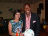Benno presents a prize to a lucky lady
