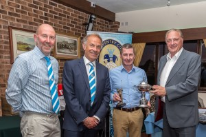 John (far right) presents Andy with the Builbase Cup. CCFPA's Jim Brown & Joe Elliott add their congratulations.