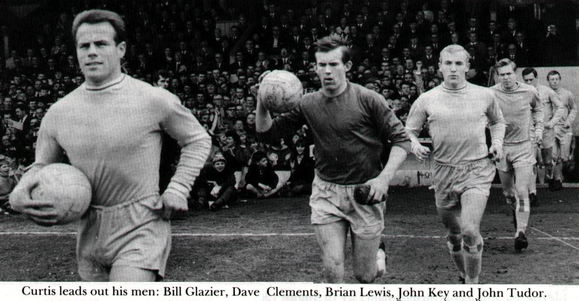 Action- 1963(c) Curtis leads out team