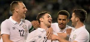 Cyrus celebrates with scorer Robbie Brady