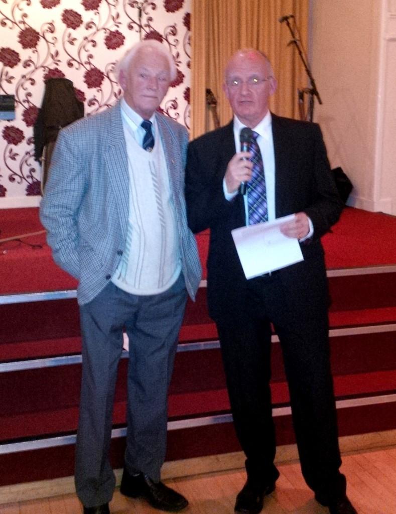 Ken (left) makes the presentation