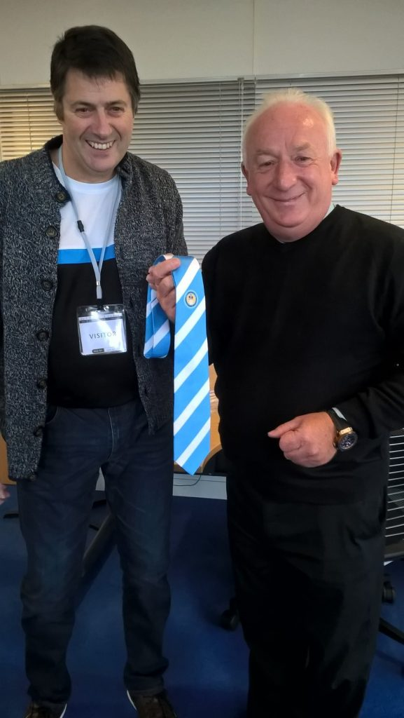 Paul (right) presented with his Association tie by Dean